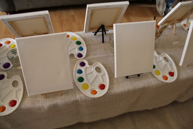 Rainbow party ideas: set up easels with rainbow paint trays