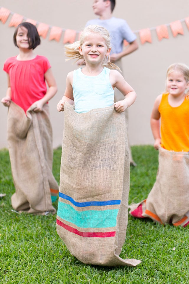 Colorful DIY painted potato sacks, plus really great ideas for fun DIY backyard party games to try.