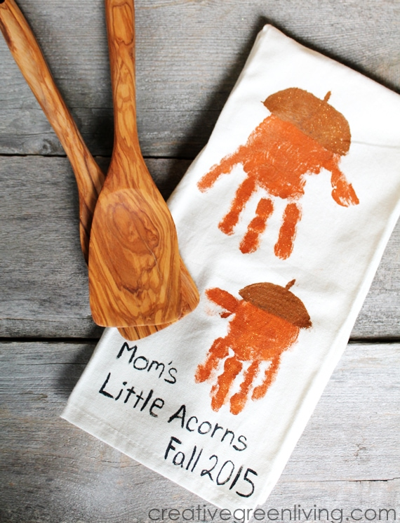 These Fall Handprint Crafts are adorable. Love his handprint acorn towel for mom