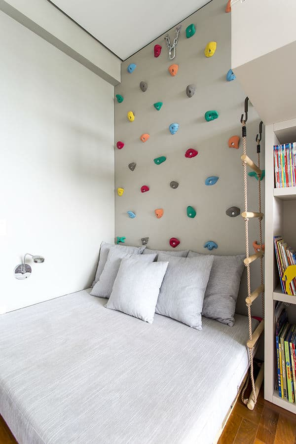 Make a climbing wall over kids bed for an easy indoor climbing area. The bed keeps landings soft! via Triplex