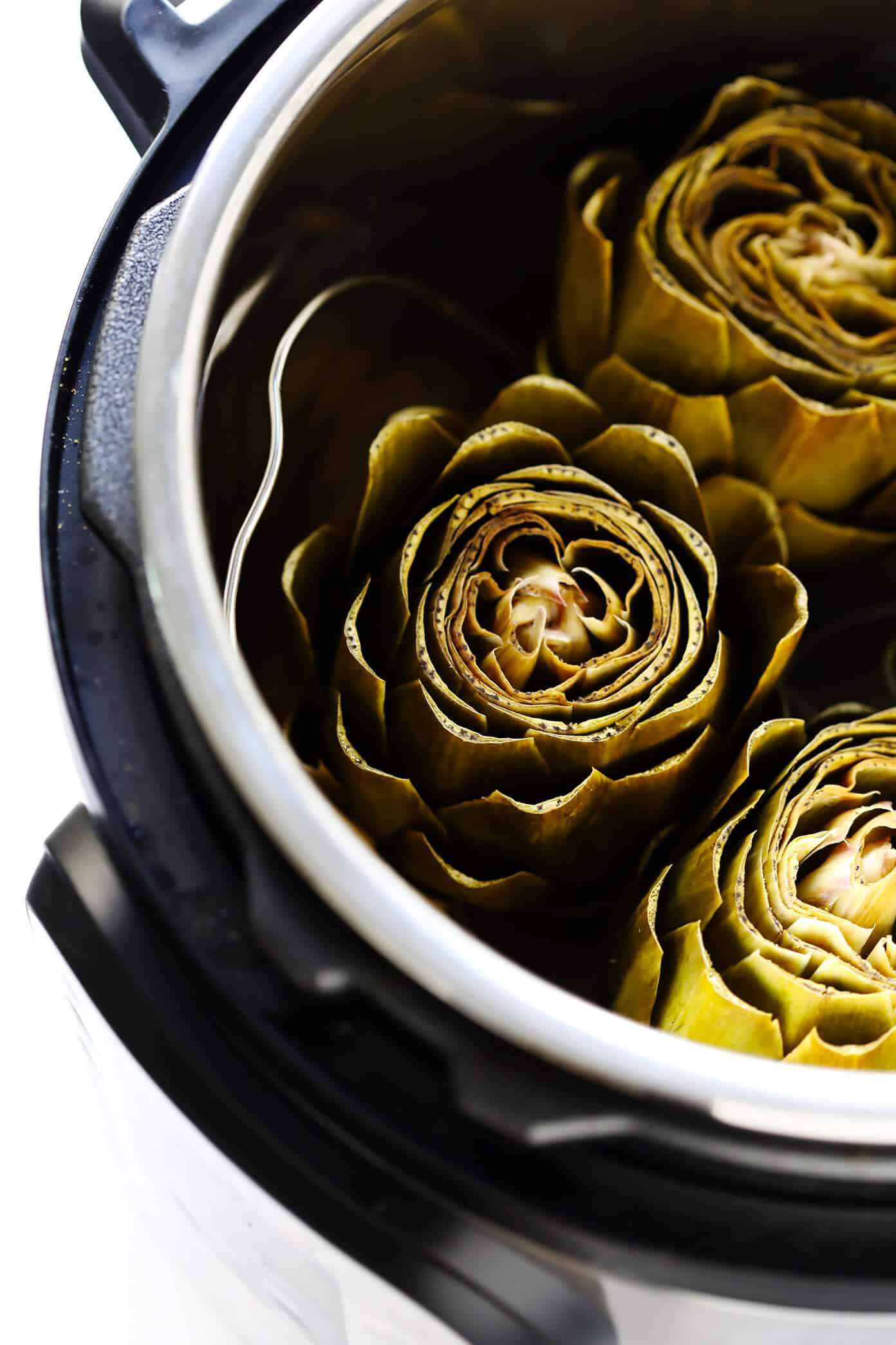 How to cook artichokes in your Instant Pot. This post has so many ways for newbies to get started with their Instant Pots! #InstantPotrRecipes