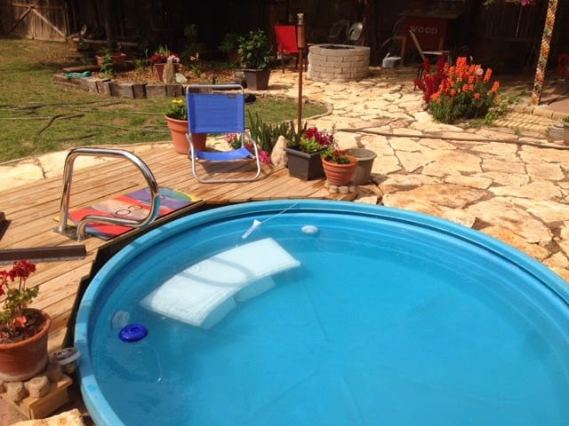 25 fun diy backyard play areas the kids will love for How to make a pool out of a stock tank