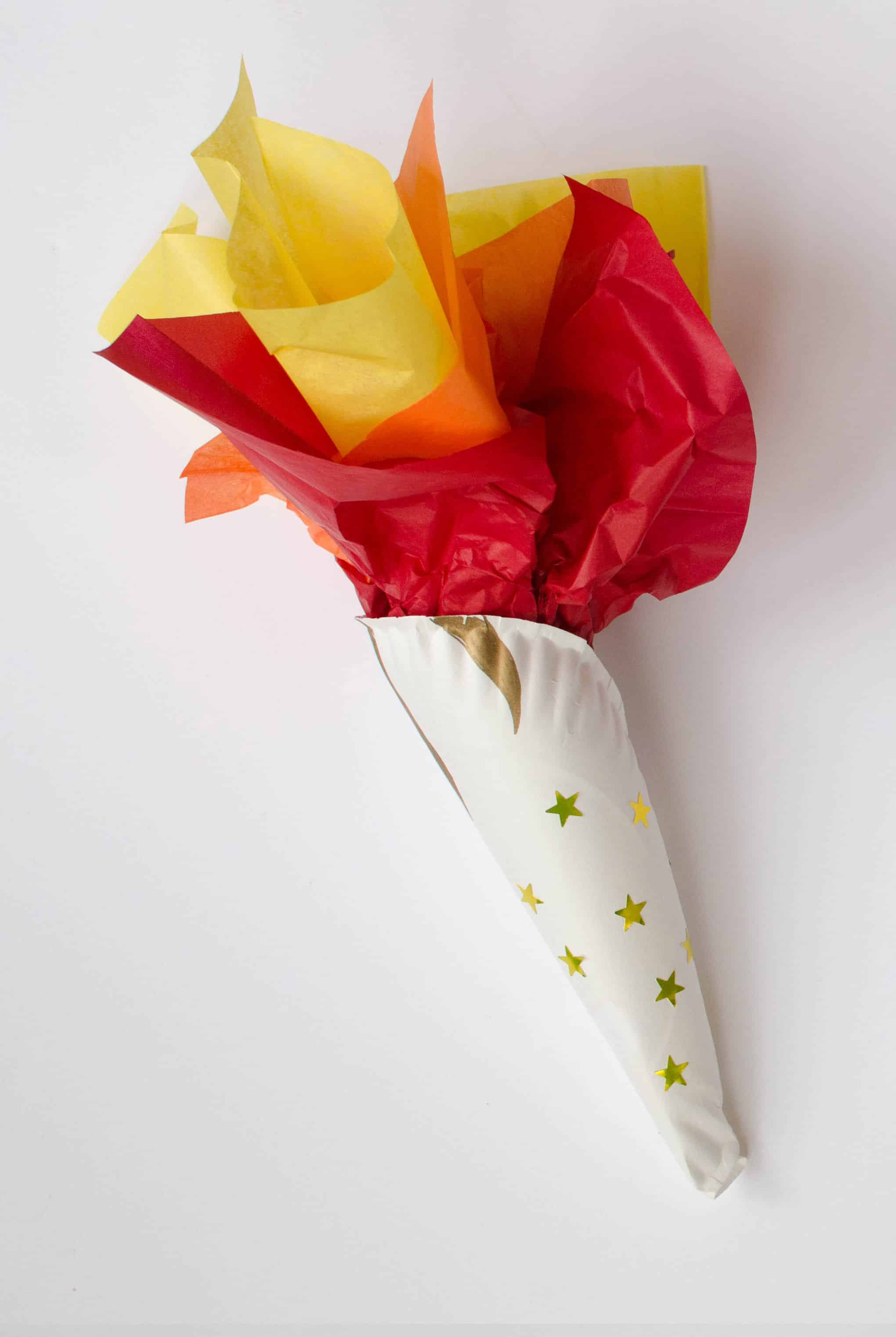 Olympic torch craft for 2018 Winter Olympics. Made with paper plate and gold star stickers.