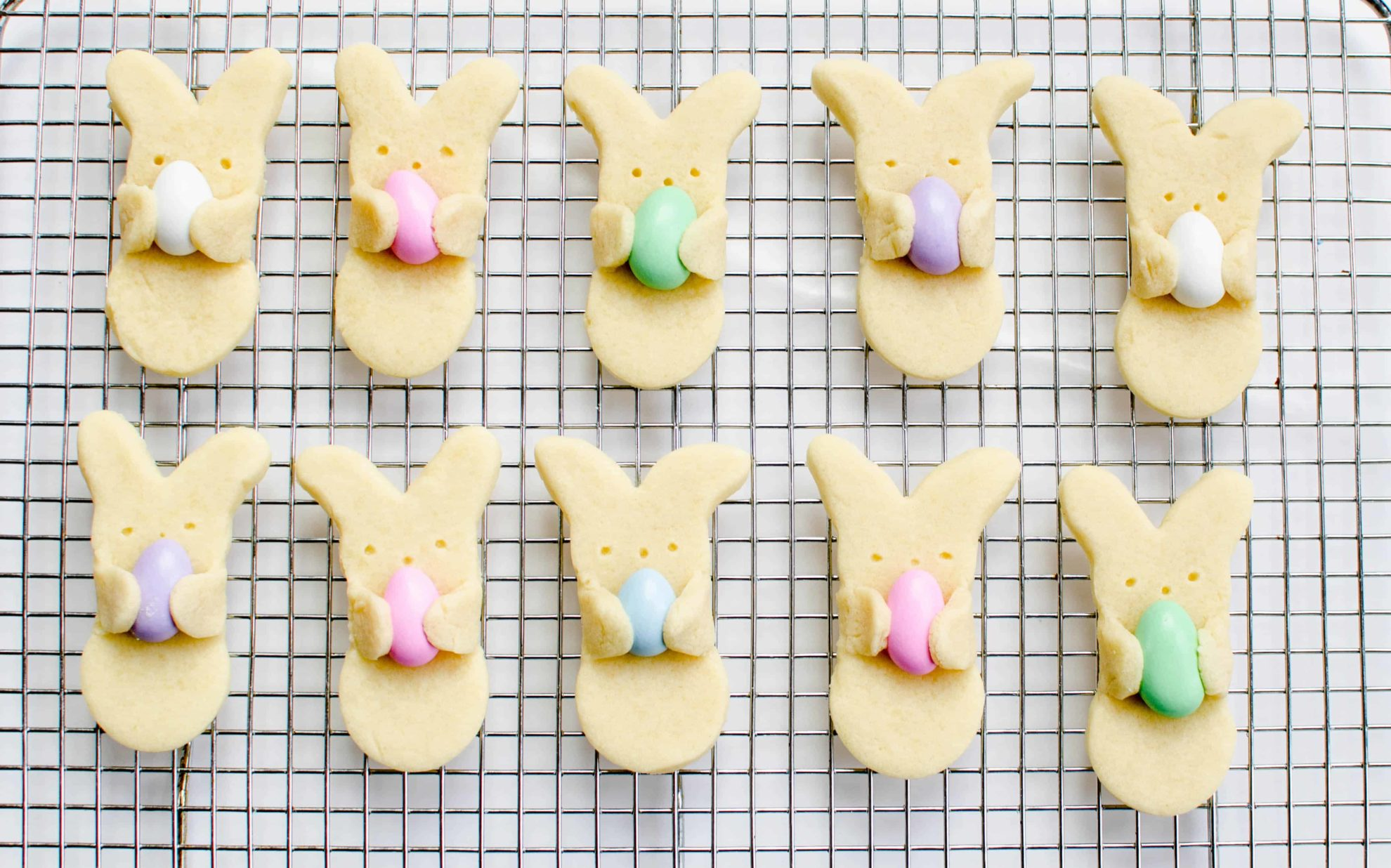 Easter bunny cookies holding Easter eggs. Cute Easter treat for kids!