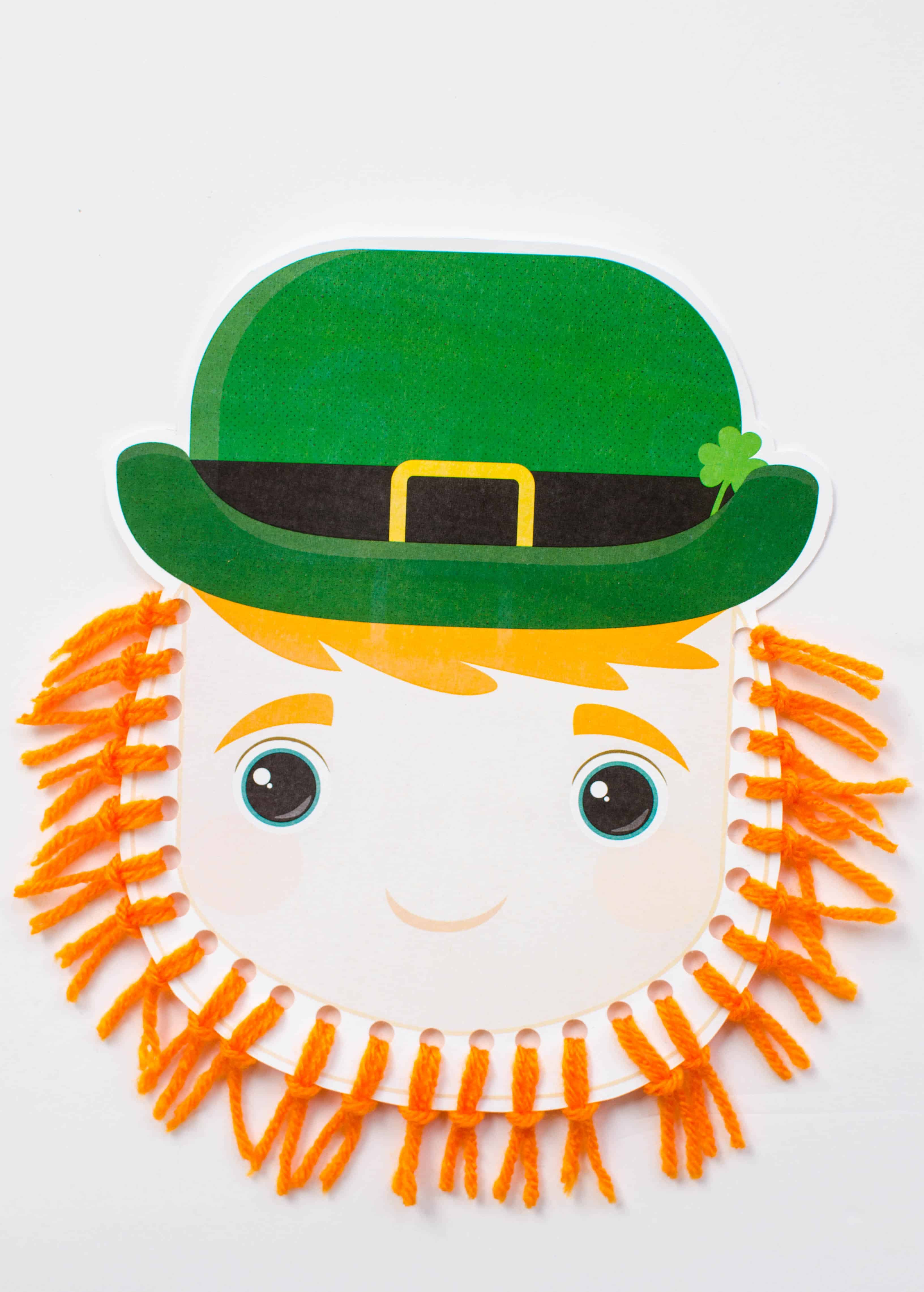 Grab some orange yarn and our free printable to make this easy St. Patrick's Day craft for kids.