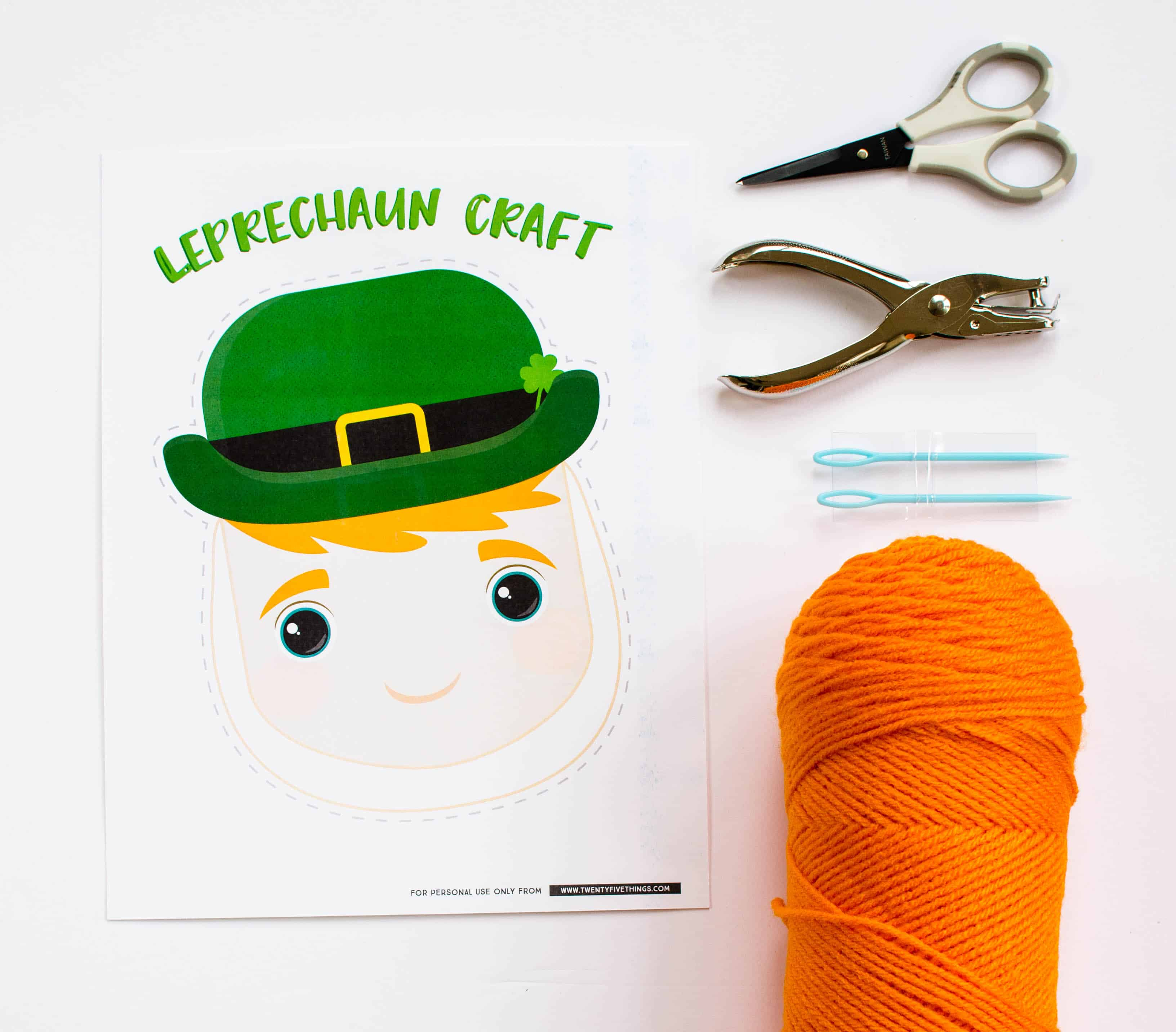 For this leprechaun craft, you'll need our printable, orange yarn, plastic sewing needles, a hole punch, and scissors.
