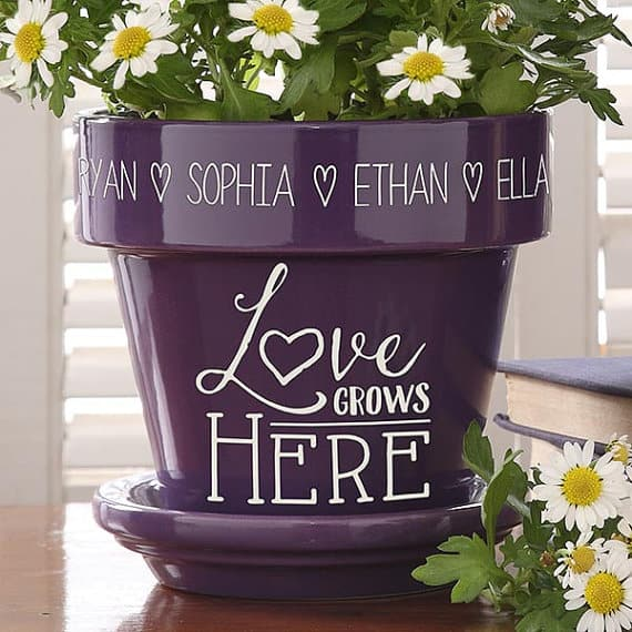 We're sharing out top picks for personalized gifts for mom. Click through for the details on this Love Grows Here planter with kids names.