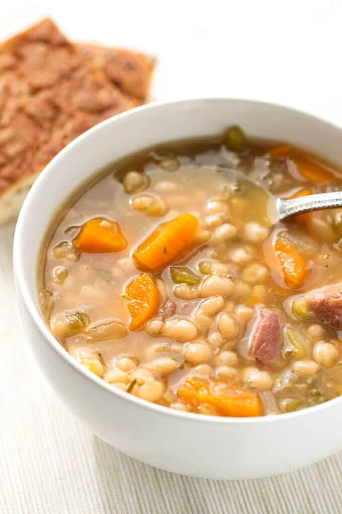 Instant Pot Dump and push start Ham Hock bean soup from Simply Happy Foodie