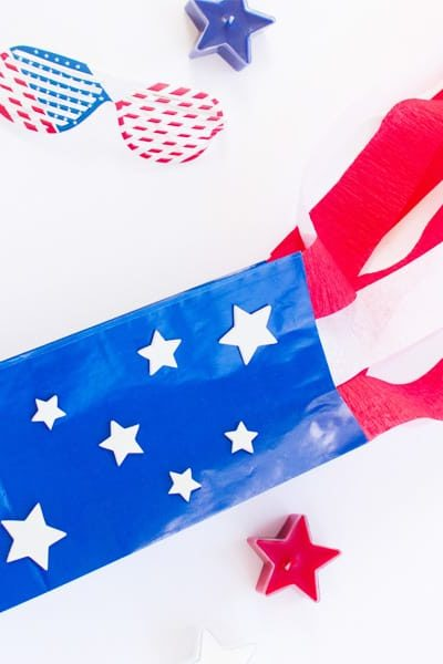 Make a paper bag kite with stars and stripes like the American Flag. Fun patriotic craft for kids.