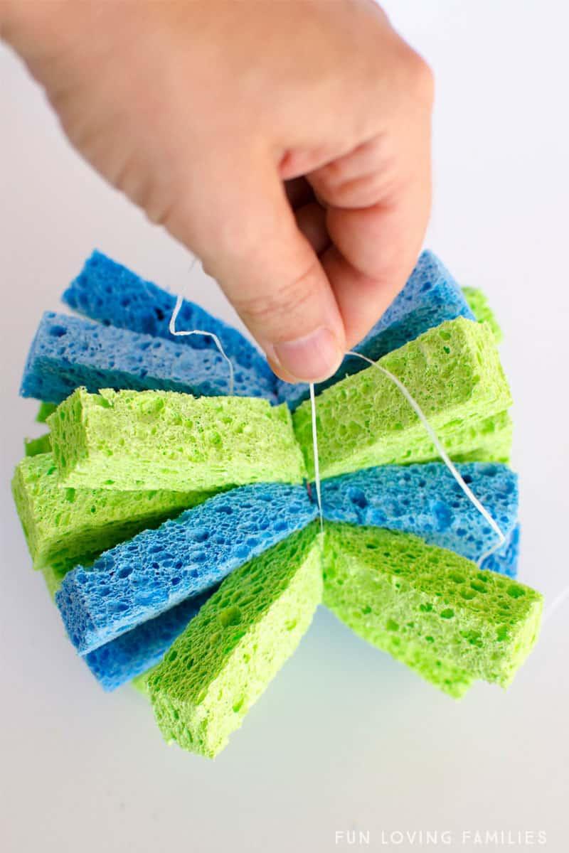 tying string around sponge strips