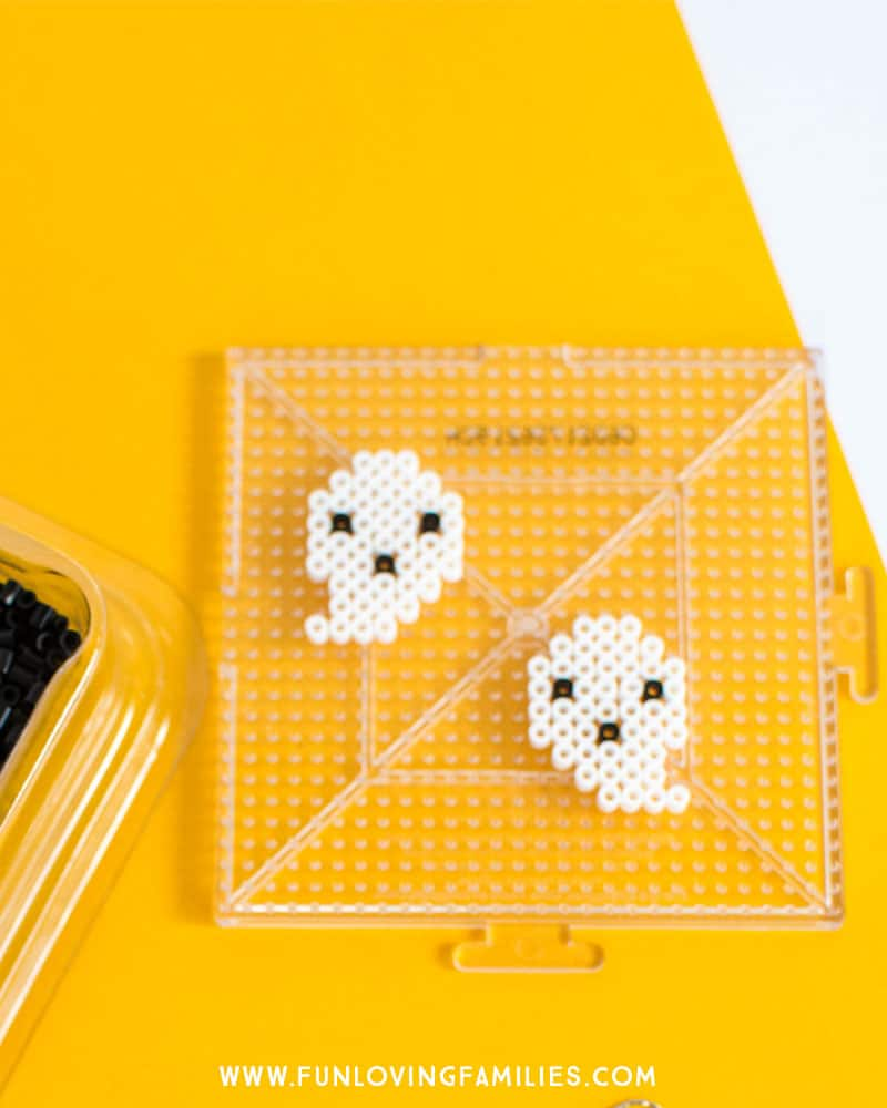 Mini perler bead ghost design. See the whole tutorial to make your own Perler Bead earrings.