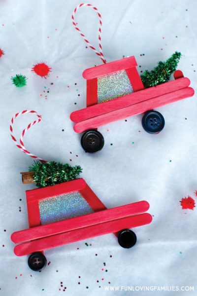 DIY popsicle stick Christmas ornaments: How cute are these little red car and truck DIY ornaments! Click through for the easy step-by-step tutorial. #Christmas #Christmasornaments #DIYchristmasornaments #handmadeornaments #farmtruckornament #christmastreecarornament #christmascar #christmastruck #christmascrafts #popsiclestickornaments