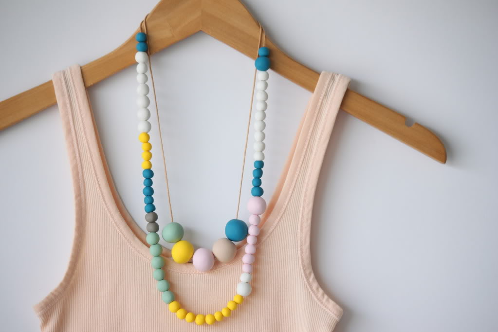 colorful clay bead necklaces and peach tank top