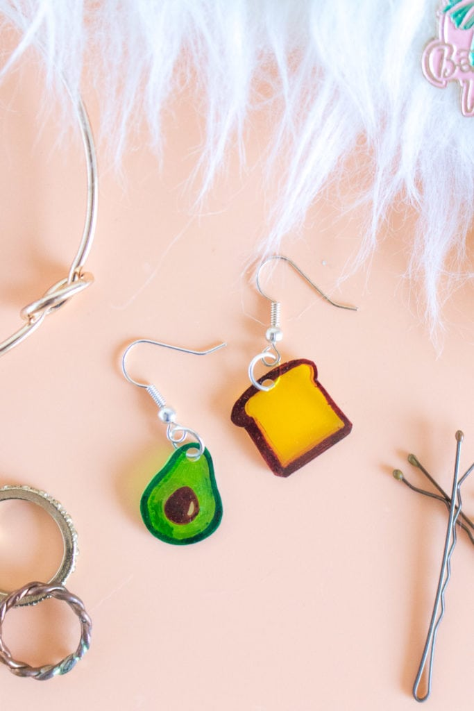 shrink plastic earrings shaped like an avocado and toast craft for tweens and teens
