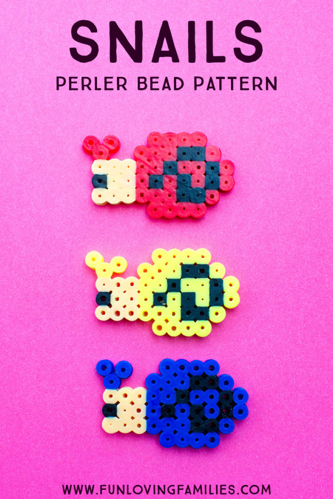Perler bead snails in red, yellow, and blue