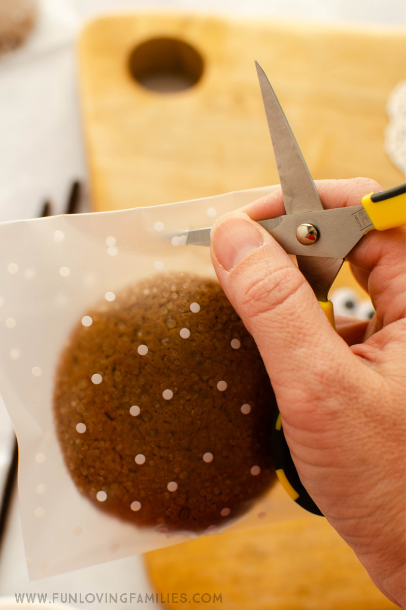 scissors cutting hole in cookie treat bag