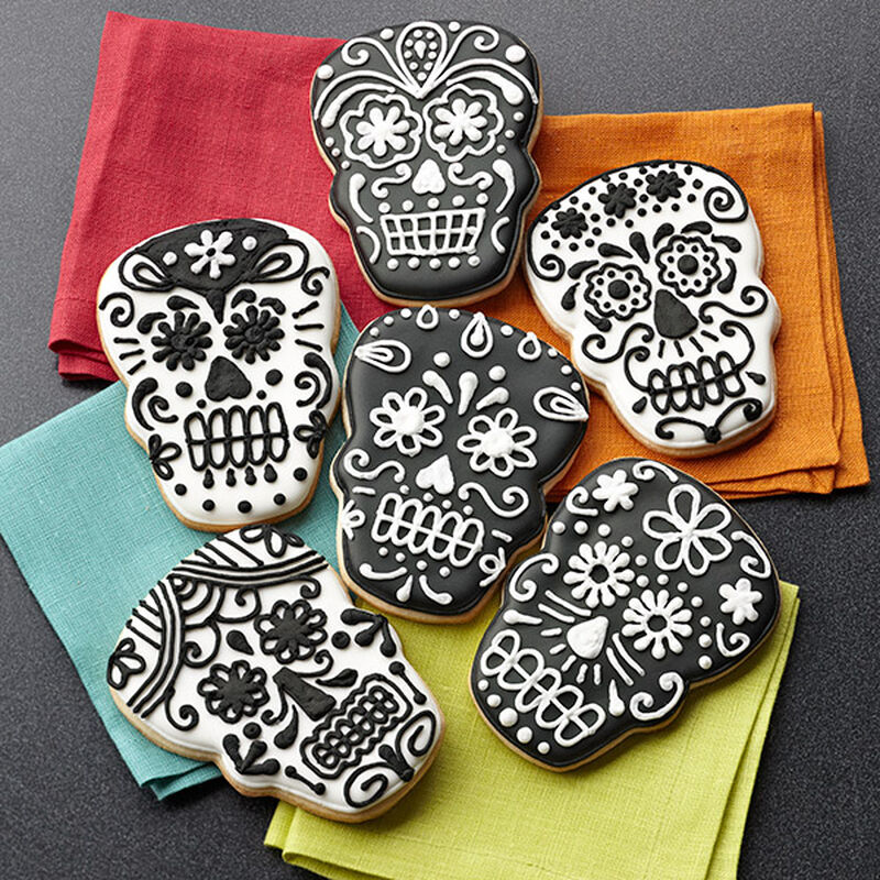 Day of the dead sugar cookie skulls with detailed piping work
