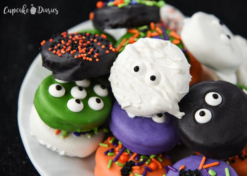 plate of dipped Oreo Halloween cookies