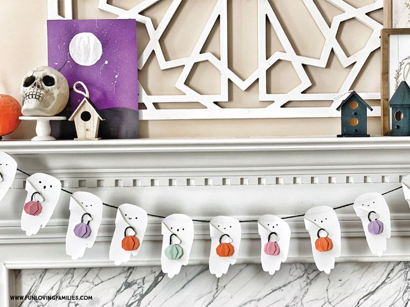 halloween handprint craft ghost bunting on mantel with colorful origami pumpkins