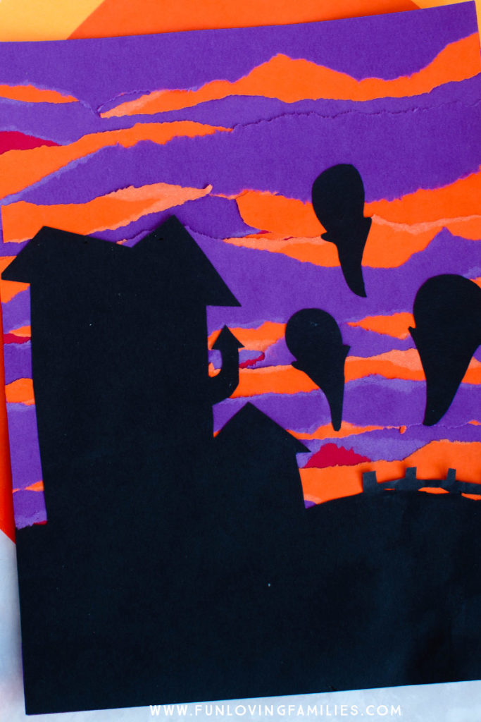 spooky scene with purple and orange torn paper background