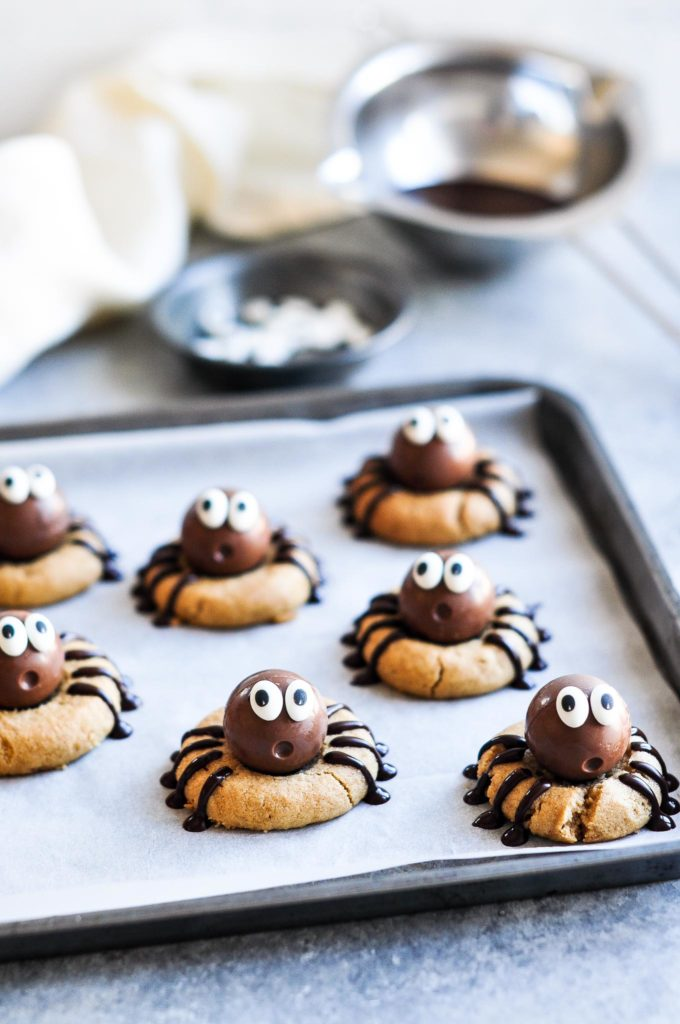 cookie sheet with peanut butter spider cookies