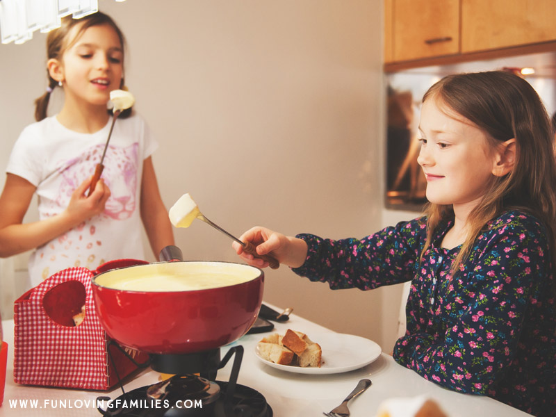 Kids eating fondue for Christmas Eve dinner