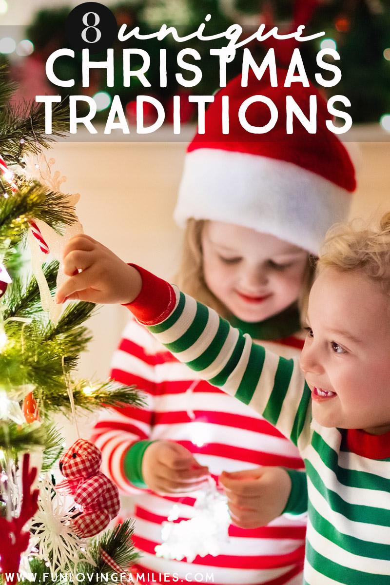 kids in Christmas pajamas adding ornament to tree