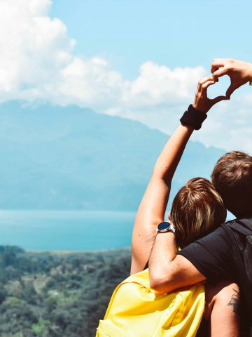 Couple having fun hiking during the summer