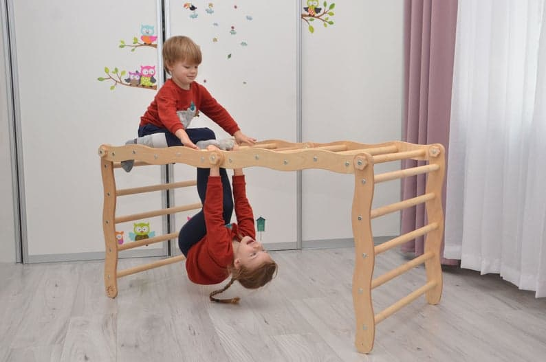 Wooden monkey bars as an indoor climbing toy for toddlers